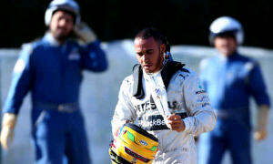 Lewis Hamilton walks away after crashing his new Mercedes car in testing in Spain.Getty Images